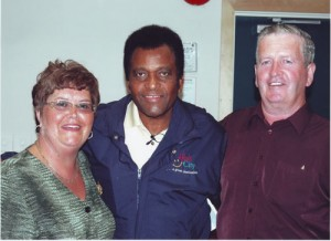 Susan Butler with Charlie Pride, one of the many famous performers she has brought to Miramichi.